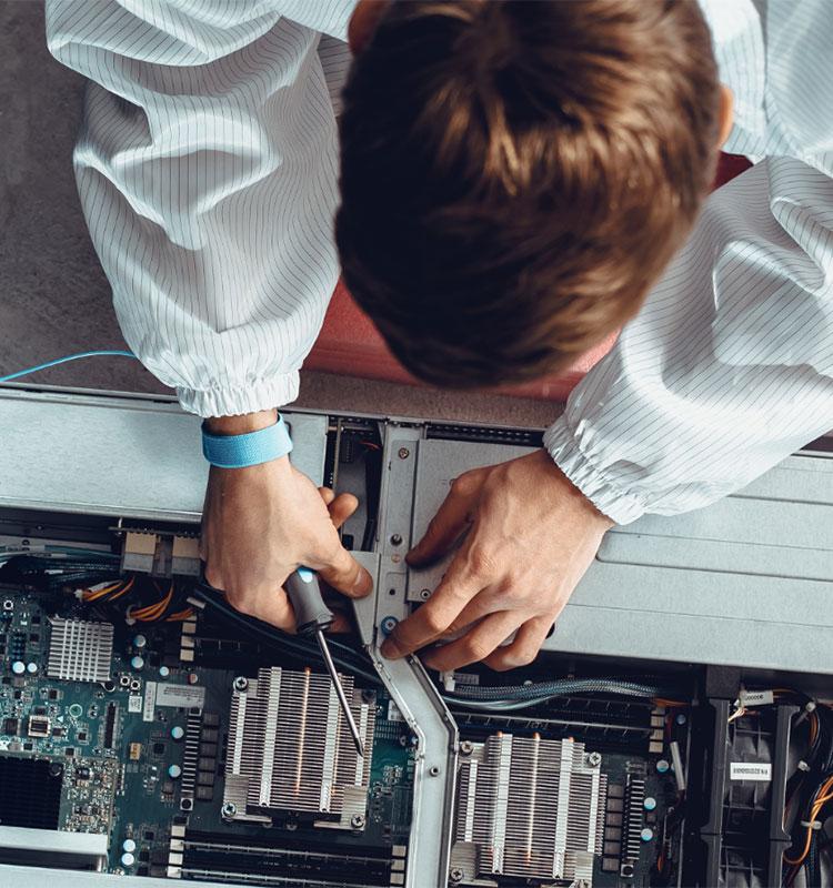 SCIT student repairing computer